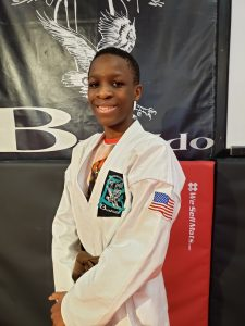 teen in karate gi
