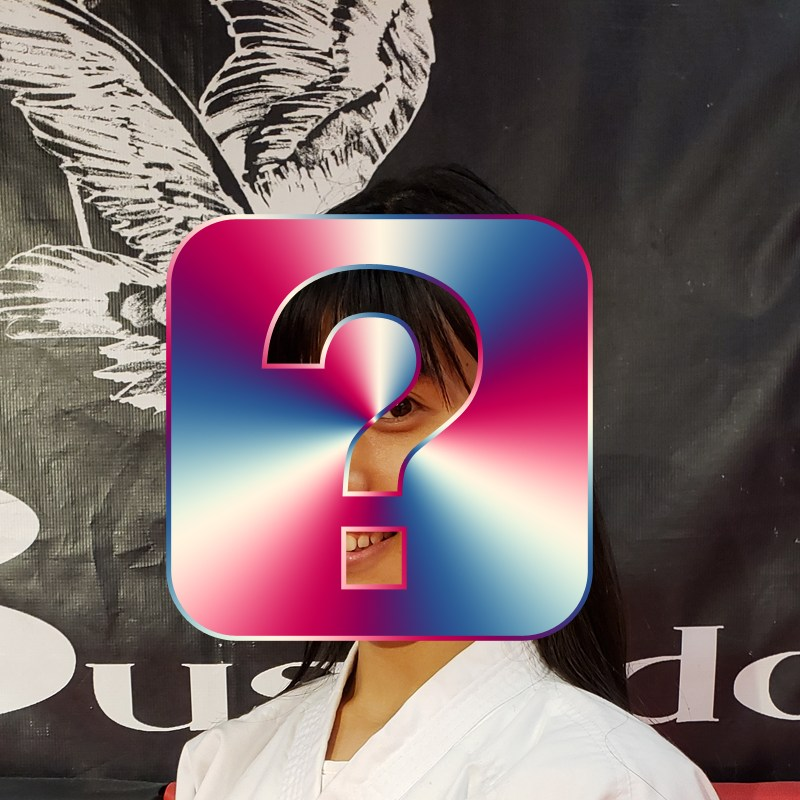 female karate student behind a question mark