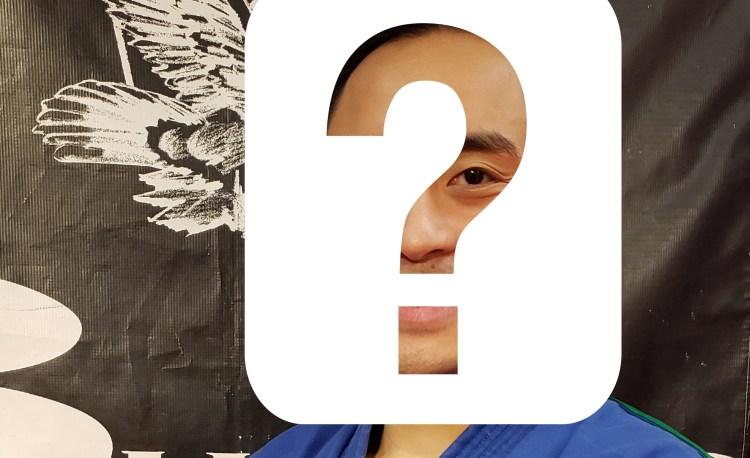 man wearing karate uniform with hidden face