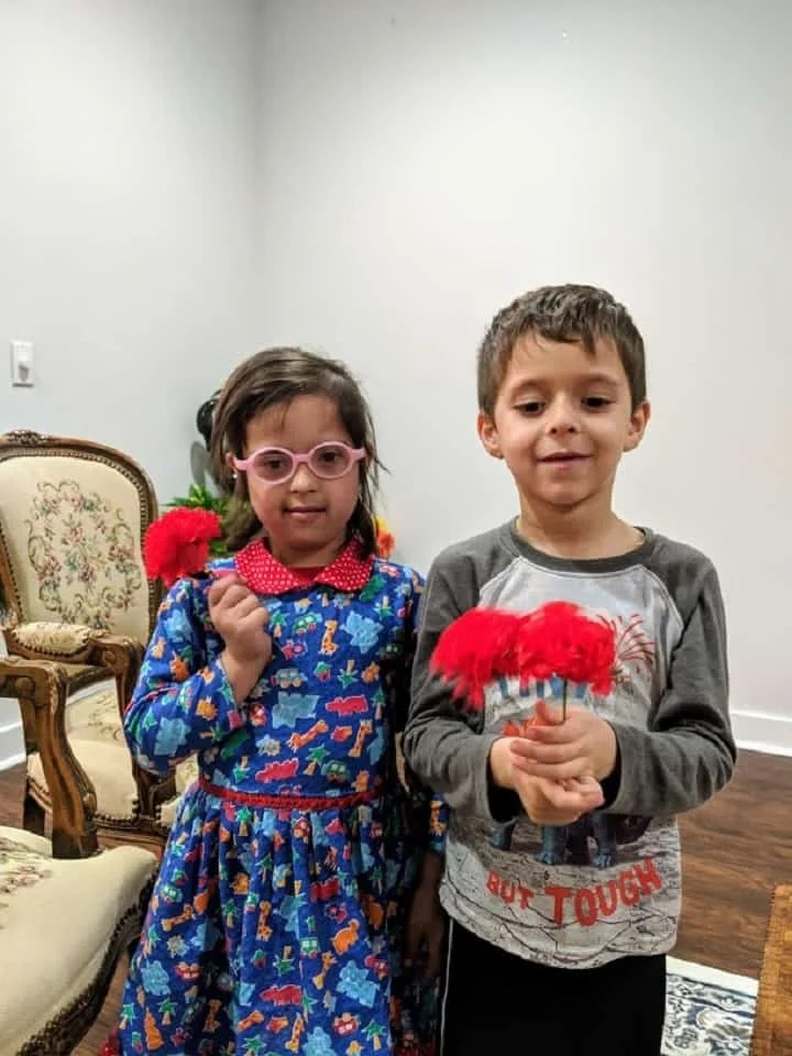 Down Syndrome girl with her brother