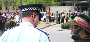 palm-island-demonstration-burragubbah-spk-as-sam-negotiates-with-policeman.jpg
