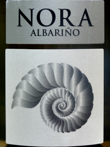 Nora Albariño 2017; classic, elegant albariño. Highly aromatic, pear and honeysuckle aromas. Apricot, pear, melon with citrus uplift. Structured. From one of leading producers in Rias Baixas.