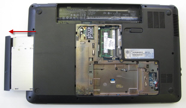 Remove DVD drive. Careful so that plastic does not break on DVD drawer