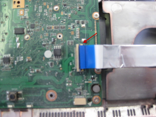 Detach the ribbon from the motherboard by lifting the brown clip.