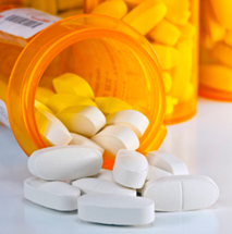 Prescription Medication Spilling From an Open Medicine Bottle