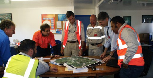 Hides gas Development Company's Libe Parindali (far right) meets with the operations team from ExxonMobil