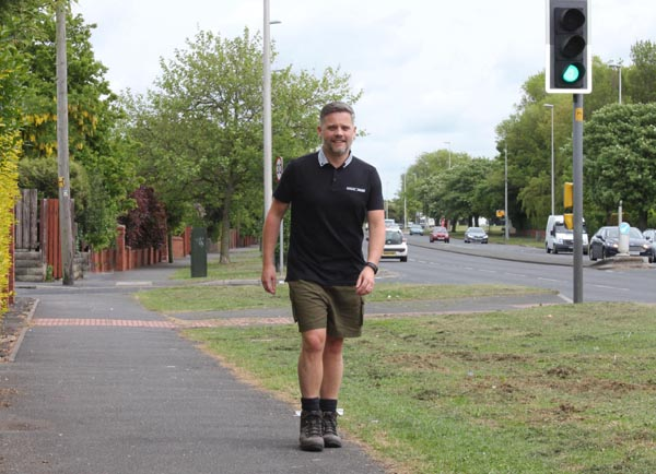 Happy Creative director putting his best foot forward for charity