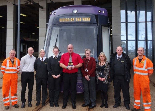 Tram team with award