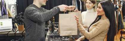 female customers getting paper bags at counter desk