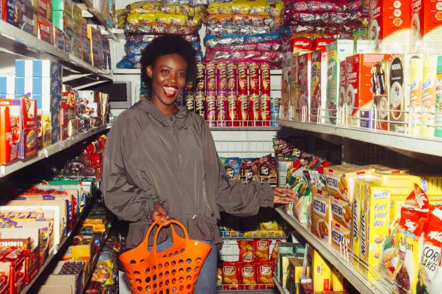 Great customer service is a zero cost strategy to make customers come back for repeat purchase. Funny black woman choosing food in grocery shop.