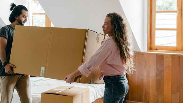 focused diverse couple relocating in new house