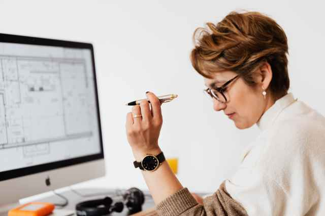 concentrated adult female thinking to illustrate perception bias in decision making