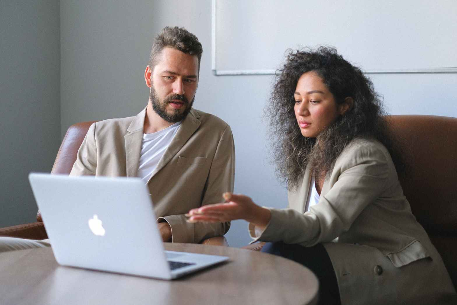 focused man working with female colleague in office