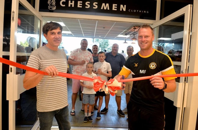 Crowds Flock to See Iconic Newport Store Re-Open