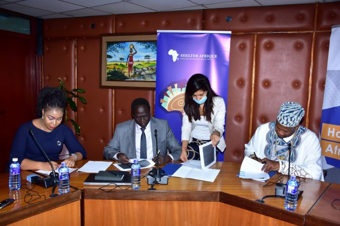 Triangle Real Estate Chief Executive Officer Amb. Arop Deng Kuol, and Shelter Afrique Chief Executive Officer Andrew Chimphondah sign the USD1.5bn housing deal in Nairobi witnessed by Benchmark Solutions Managing Director Laura Akunga and Shelter afrique's head of legal Houda Boudlali.