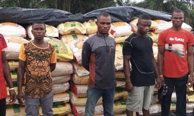 Navy hands over contraband rice, suspects to Customs