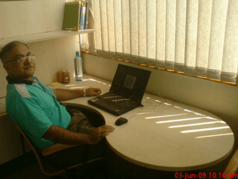 The author at his desk at Praxis Business School, Calcutta