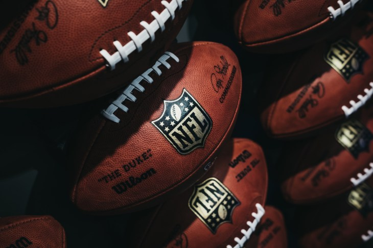 Rows of american football balls in NFL Experience in Times Square, New York,