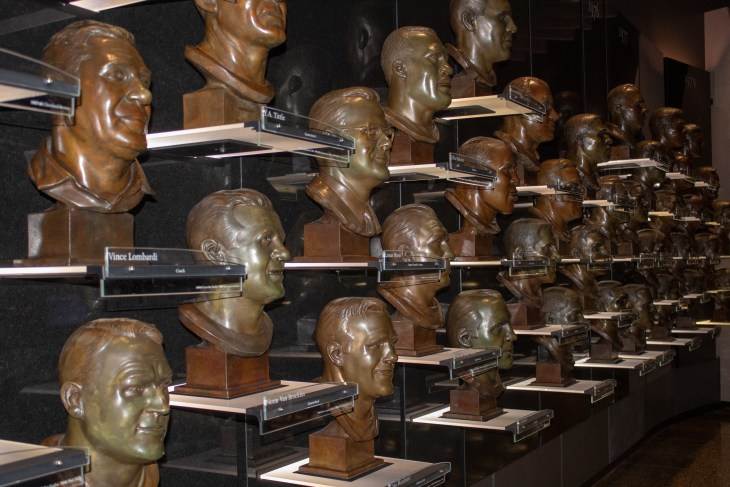 Canton, Oh / USA - April 17, 2019: View of wall with Pro Football Hall of Fame inductees bronze busts.