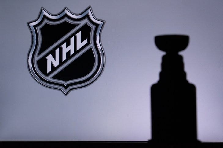 TORONTO, CANADA, 17. JULY: National Hockey LeagueLogo of NHL club on the screen. Stenley Cup Trophy Silhouette.