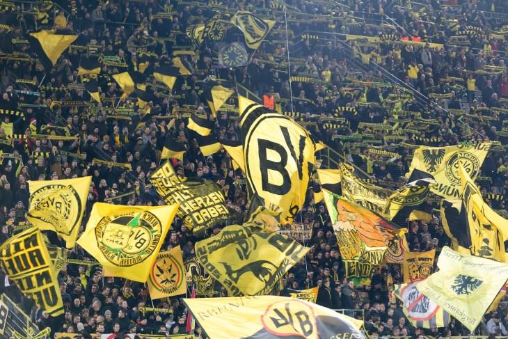 Dortmund, Germany- December 10, 2015: Dortmund fans celebrating for their team during the match UEFA Europa League match between PAOK vs Borussia Dortmund played at BVB Stadium