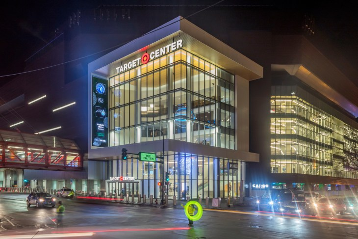 MINNEAPOLIS, MN - JANUARY 2019 - A Wide Angle Shot Traffic in front of the Target Center before a Timberwolves Game during a Winter Night
