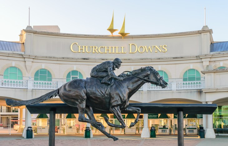 LOUISVILLE, KENTUCKY, USA - APRIL 3 2016: Entrance to Churchill Downs featuring a statue of 2006 Kentucky Derby Champion Barbaro.