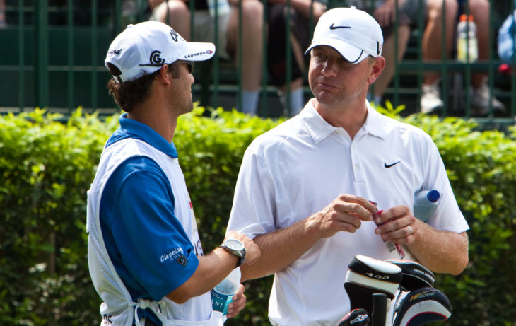 CROMWELL, CT - JUNE 25: Golfer Lucas Glover speaks with his caddy while participating in the Travelers Championship on the TPC River Highland Golf Course June 25, 2009 in Cromwell, CT.