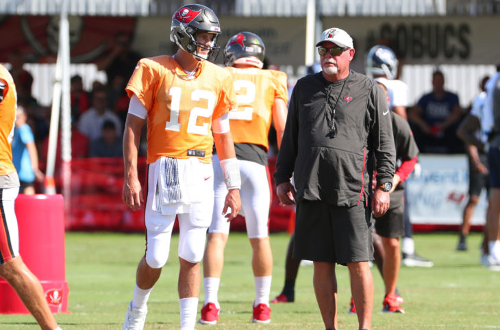 Aug 18, 2021; Tampa, FL USA; Tampa Bay Buccaneers quarterback Tom Brady (12) talks with head coach Bruce Arians during NFL training camp.