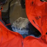 The soaked tissue behind the zipper  on the inside of the coat
