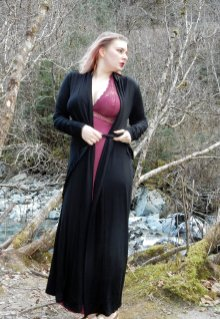 This floor length black robe features a silk sash.and is incredibly soft.