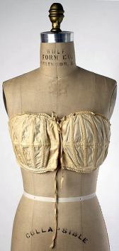 An early bra from around 1913 featuring a series of vertical stays (photo from The Metropolitan Museum of Art)