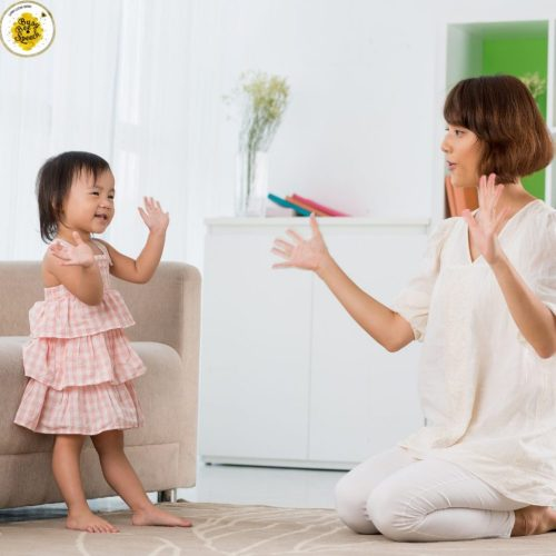 lady and child imitating actions