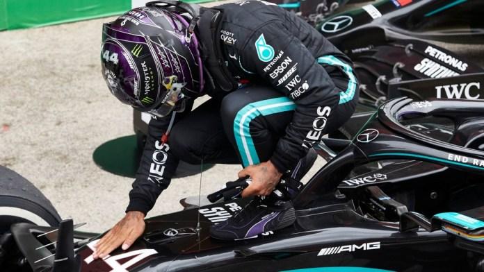 Lewis Hamilton takes historic 100th pole in Barcelona