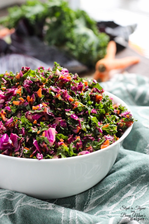 Hearty and healthy kale, cabbage and carrot slaw with a tangy vinaigrette. The perfect slaw for fall l Steph in Thyme for Busy Mom's Helper