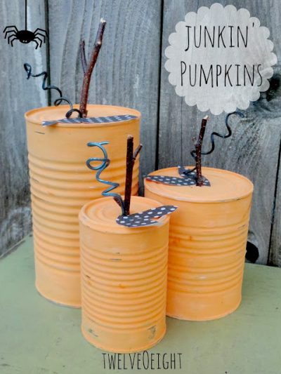 painted tin can pumpkins