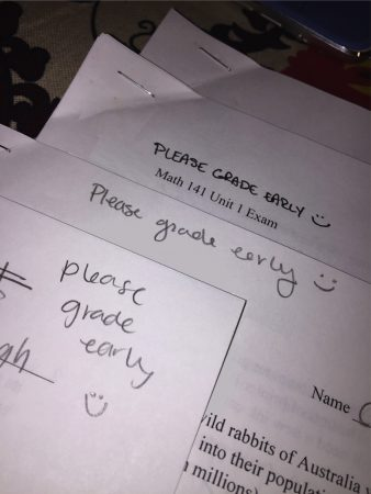Handwritten notes from three students that say Please Grade Early with smiley faces