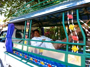 ::smart man, hammock in the tuk tuk::