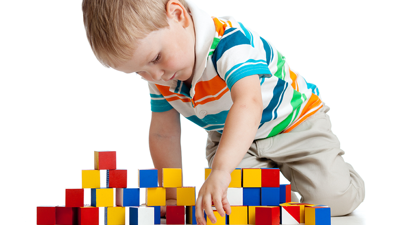 Kid Playing with Blocks at Buttercups Childcare