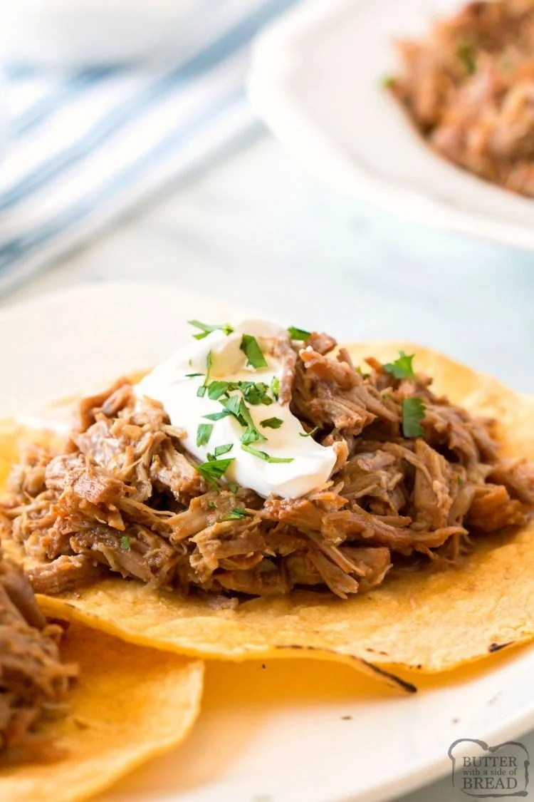Slow Cooker Pork Carnitas recipe yield a tender, flavorful pork. This carnitas recipe is easy to make in the crock pot and perfect for serving a crowd. Pork Carnitas taste incredible in a warm tortilla topped with avocado, cilantro and a dollop of sour cream.