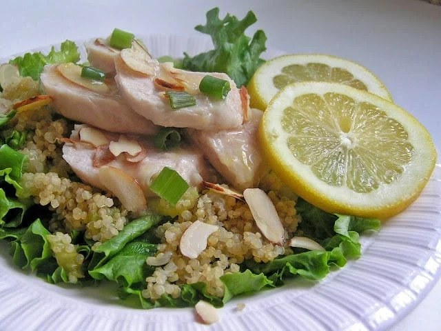 Tangy sweet lemon chicken served over a bed of rice and fresh leafy green lettuce sounds like a spring/summer dish if I ever heard one!