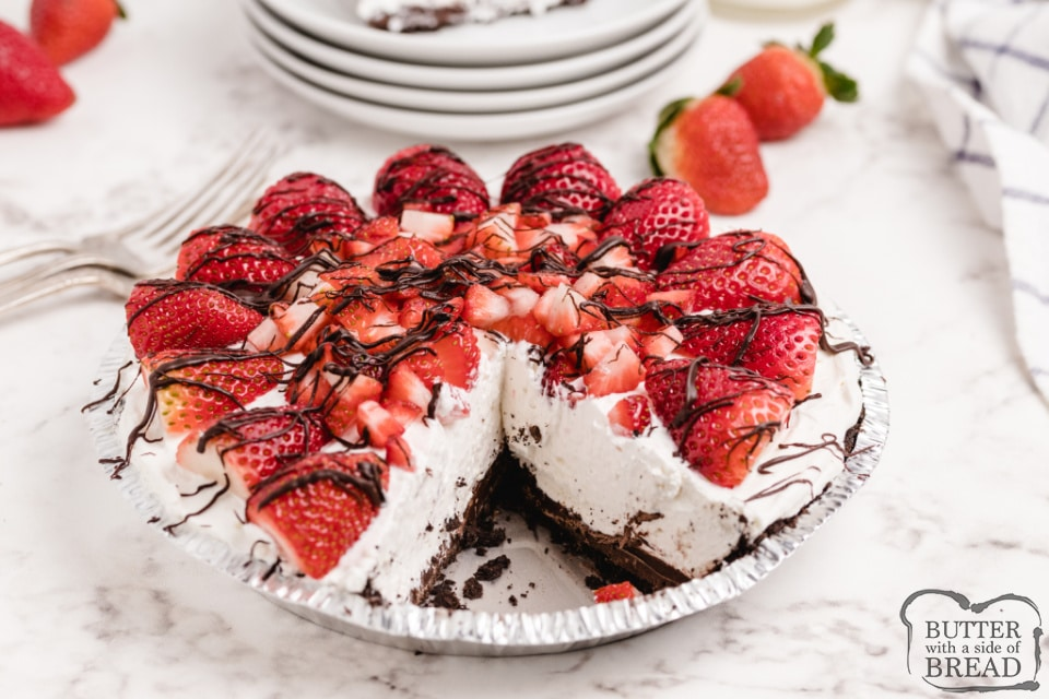 Strawberries and Cream Pie is a delicious no-bake pie recipe that is light and refreshing and so easy to make! Sweet cream cheese filling in an Oreo crust, topped with tons of fresh strawberries!