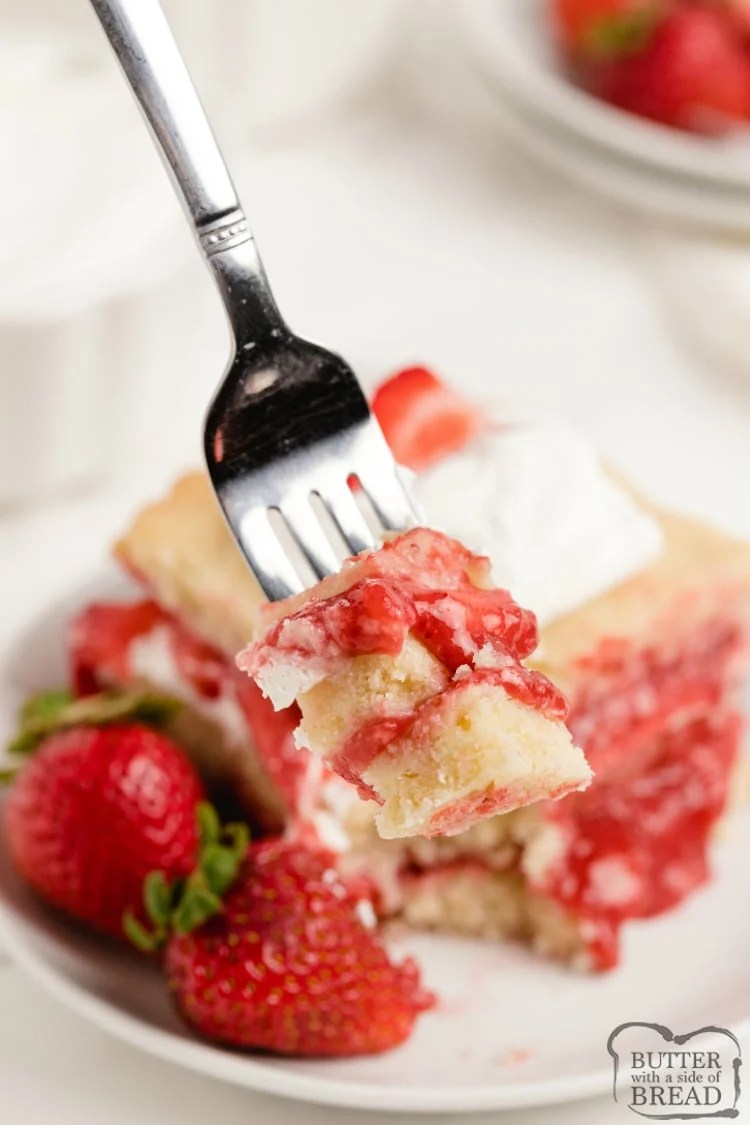 Strawberry Shortcake Bars are made with layers of sugar cookies, fresh strawberries, homemade strawberry syrup and sweetened whipped cream. These icebox cookie bars are somewhere in between traditional strawberry shortcake and fruit pizza.