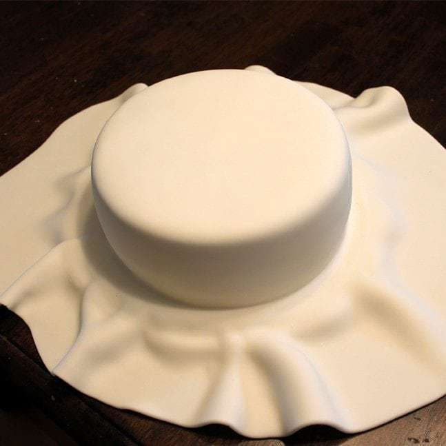 How to cover a cake in fondant:Butter with a side of bread