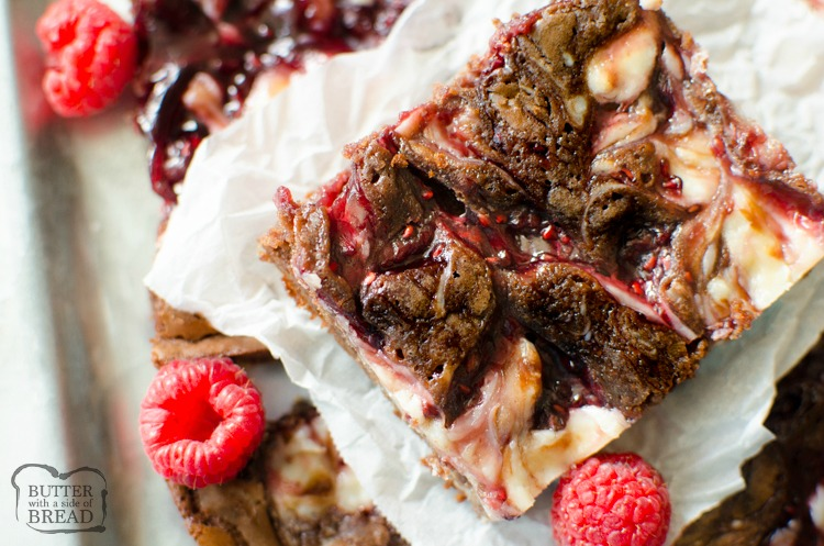 Raspberry Cheesecake Brownies are decedent 5 ingredient brownies with a raspberry cheesecake swirl. Quick & easy raspberry cheesecake brownie recipe that looks and tastes incredible!