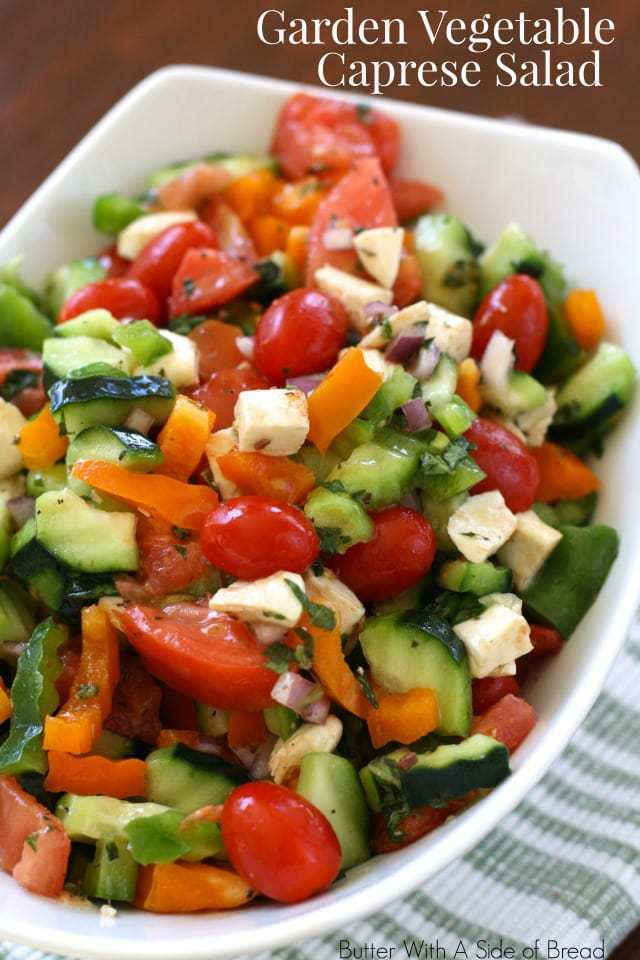 Garden Vegetable Caprese Salad made with fresh vegetables, mozzarella and a lovely red wine vinaigrette. Variation on a traditional caprese salad that's loaded with veggies!