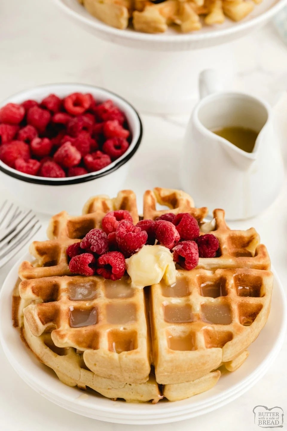 Vanilla Orange Waffles are a sweet citrus waffle served with homemade vanilla butter syrup. Fantastic variation on a traditional waffle recipe that everyone loves!