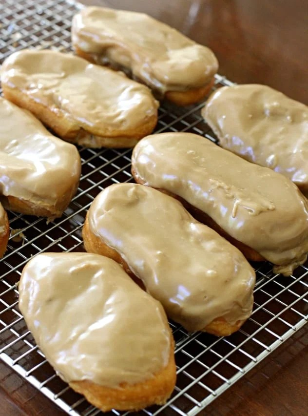 Maple Bars made in minutes with crescent dough & a delicious homemade maple glaze. Never buy store bought again after tasting these warm, fresh maple bars!