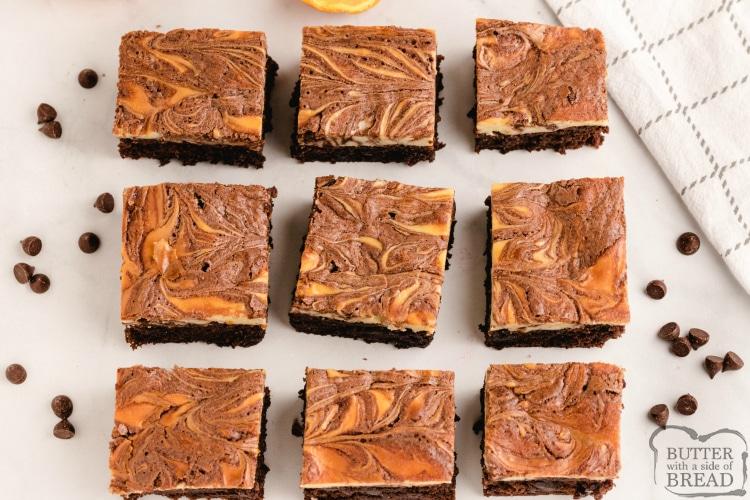 Brownies with a swirled orange cheesecake layer