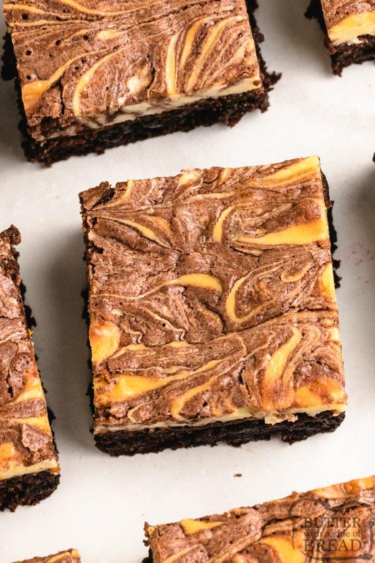 Brownies with an orange cheesecake layer swirled on top